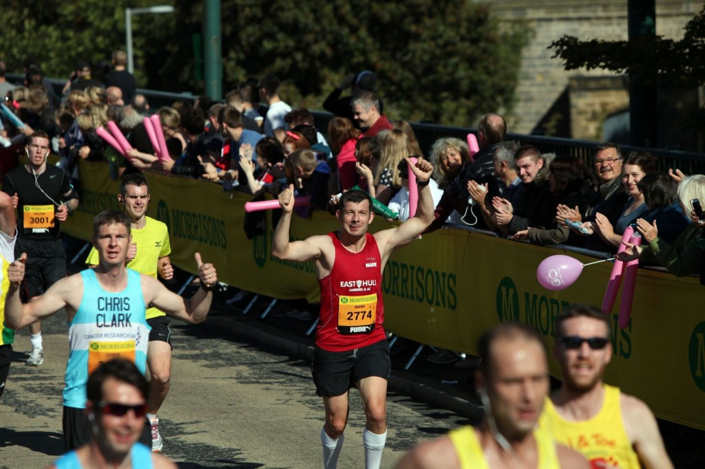 Mark Starkey at mile 2 on the Tyne Bridge. Photo courtesy of the Newcastle Chronicle.