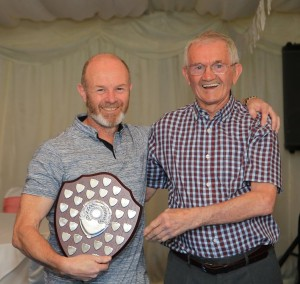 Keith Conkerton receiving the Ron Kemp trophy as overall Men's WInter League Champion from the man himself